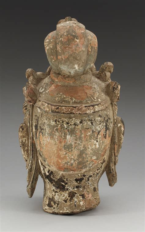 A Yuan/Ming style sculptured and painted wood head of