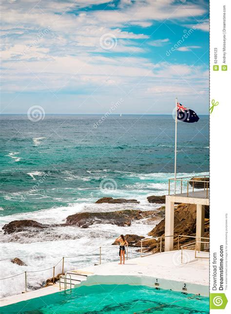 Surfer Girl Is Looking Into The Ocean At Bondi Beach